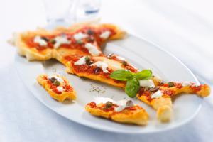 La pizza a forma d'Italia. Foto di Maurizio Lodi. Fonte: Ubik Blog